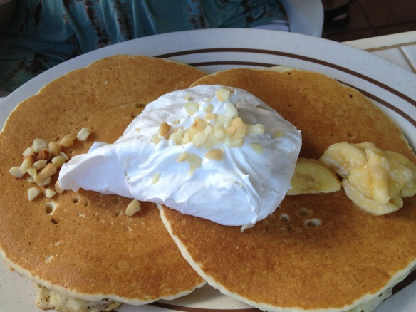 Banana macadamia nut pancakes with juuuuuuuust a dab of whipped cream.