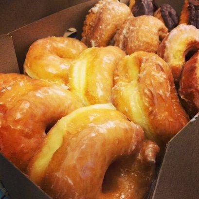 A dozen doughy little angels, living in a box.